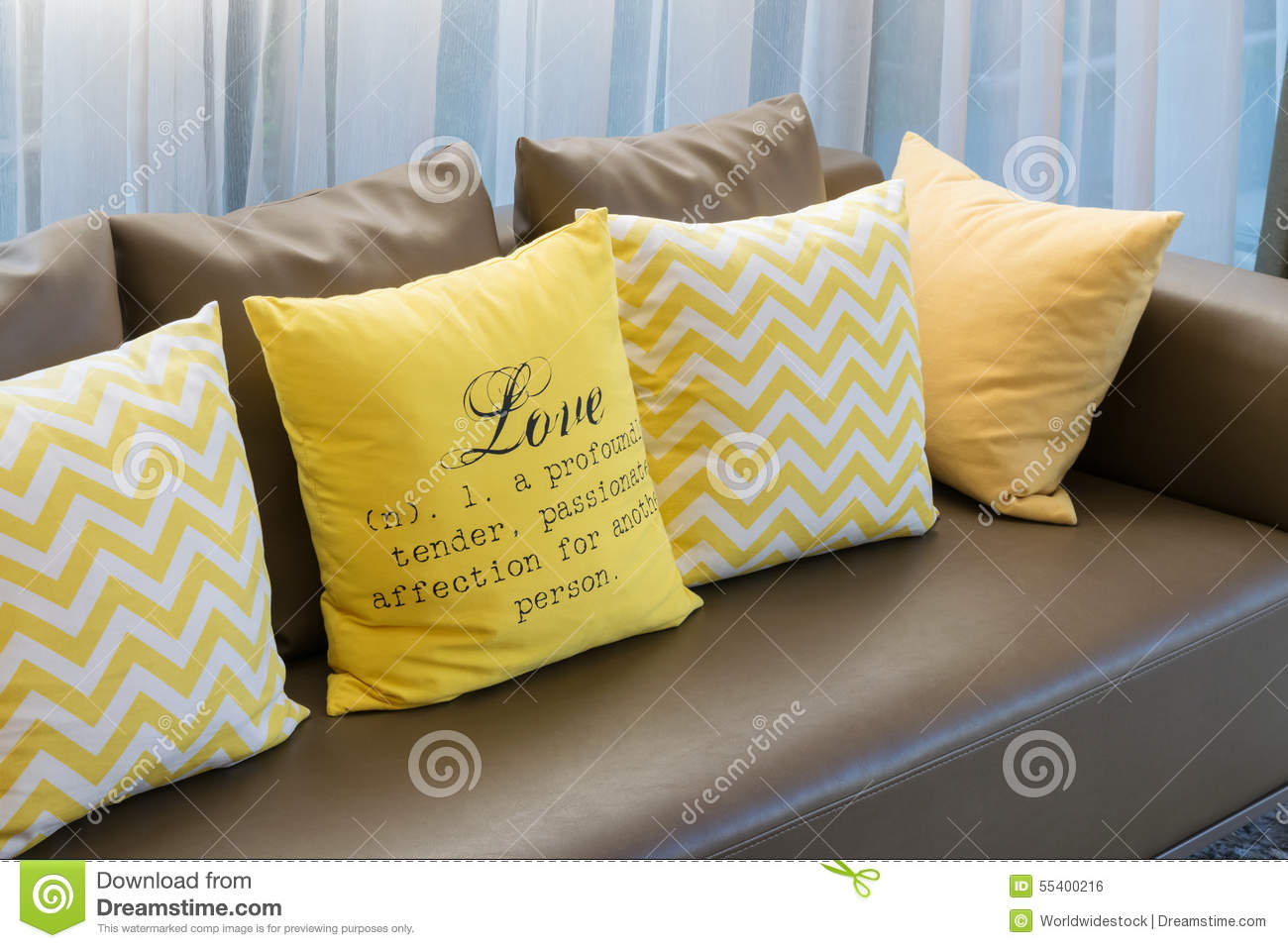 Living Room With Brown Sofa And Yellow Pillows Stock Photo