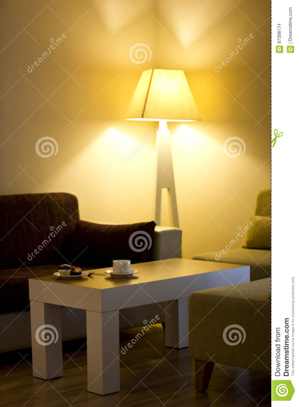 Living Room With The Cake On The Table And Big Yellow Lamp