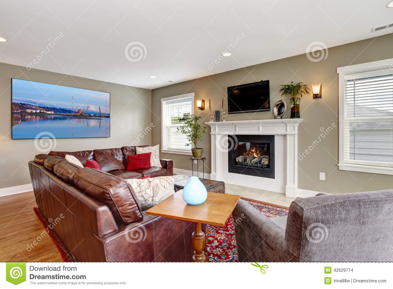 Living room with cozy fireplace and leather couch stock photo image of entertainment for Soggiorno arredato
