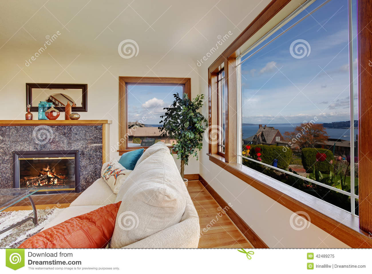 living room with fireplace and beautiful window view stock photo