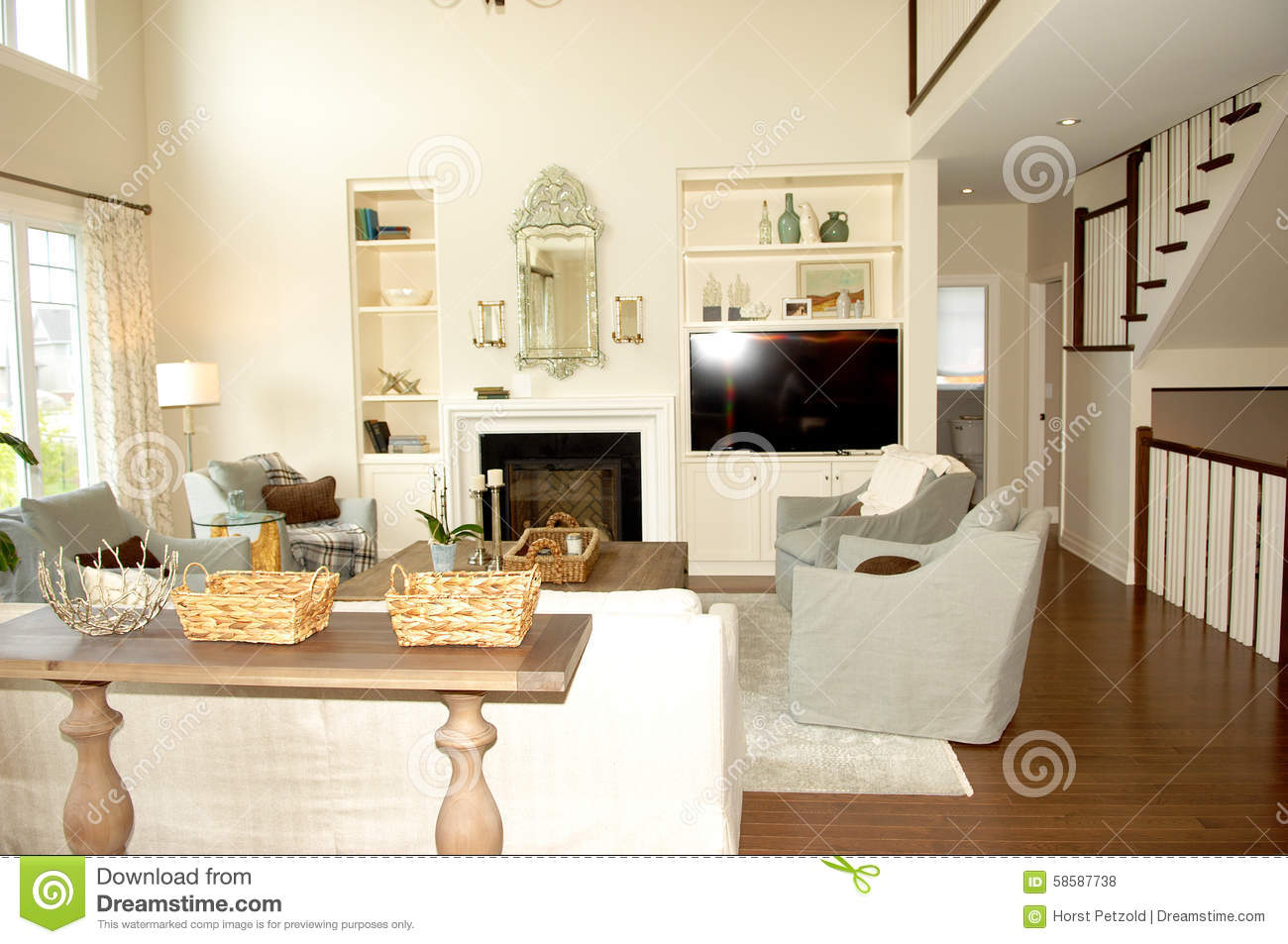 Living room with fireplace and stairs stock photo image for Comedor 20 metros cuadrados