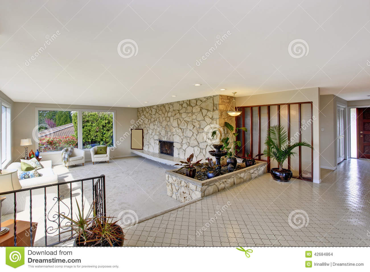 Living Room With Fountain In Luxury House Stock Photo