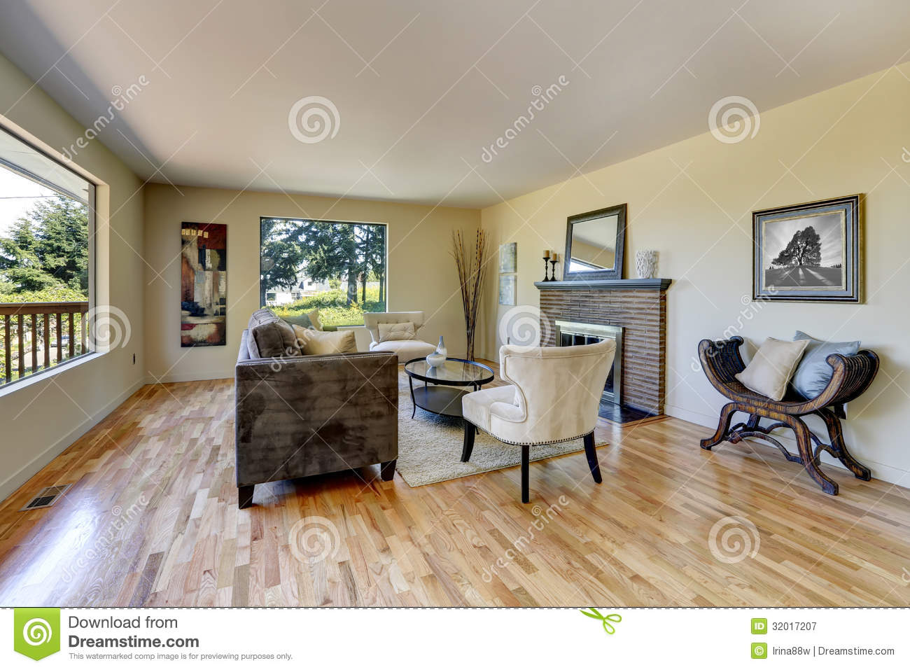 Living Room With Hardwood Floor Fireplace And Large Windows Royalty Free Stock Photography