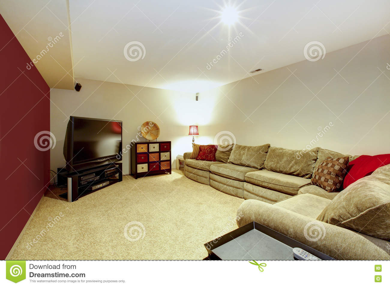 living room interior with beige sofa, carpet floor and red wall