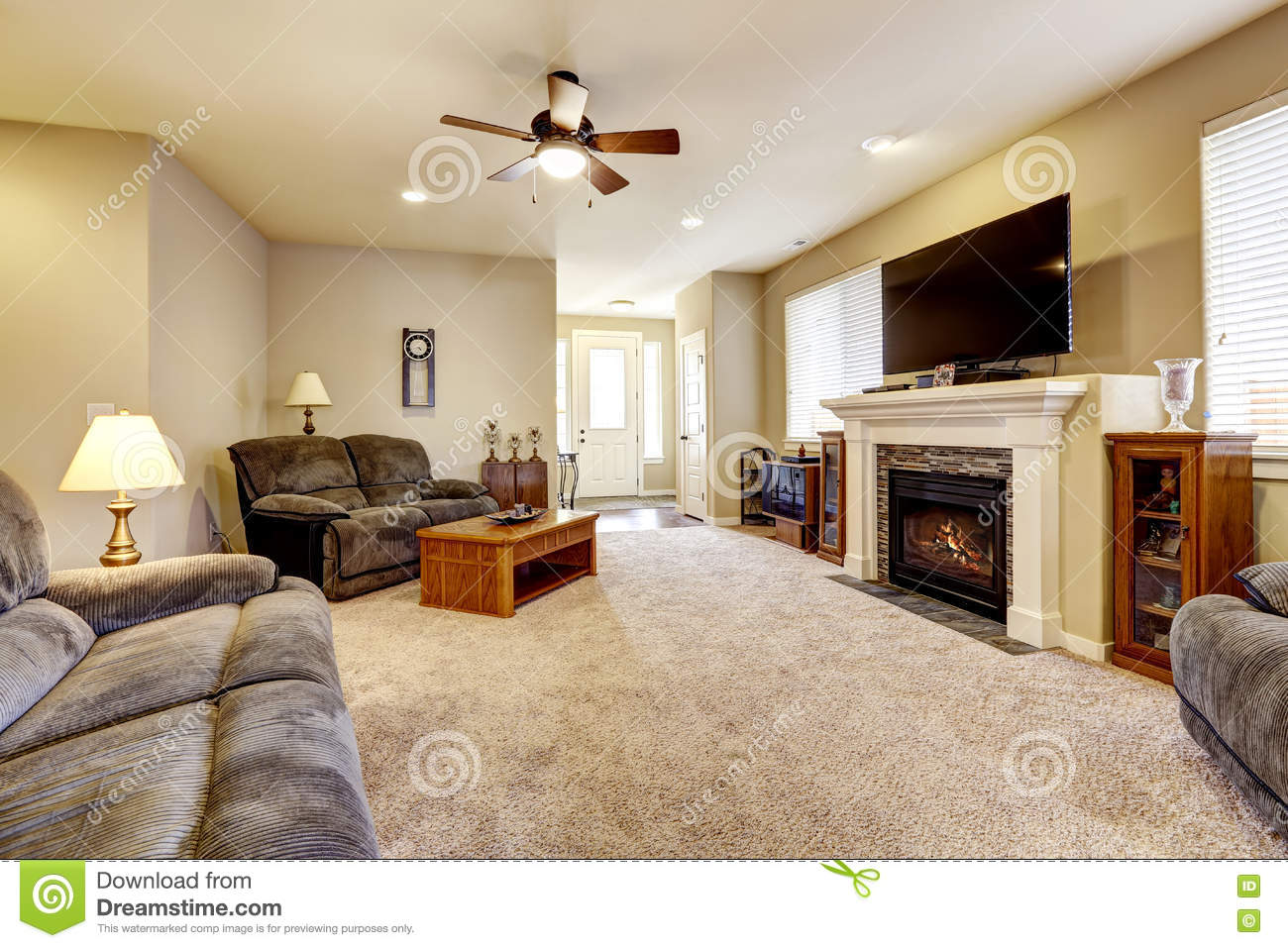 Living Room Interior In Classic American Style With Beige Walls Gray Sofa Set And Fireplace