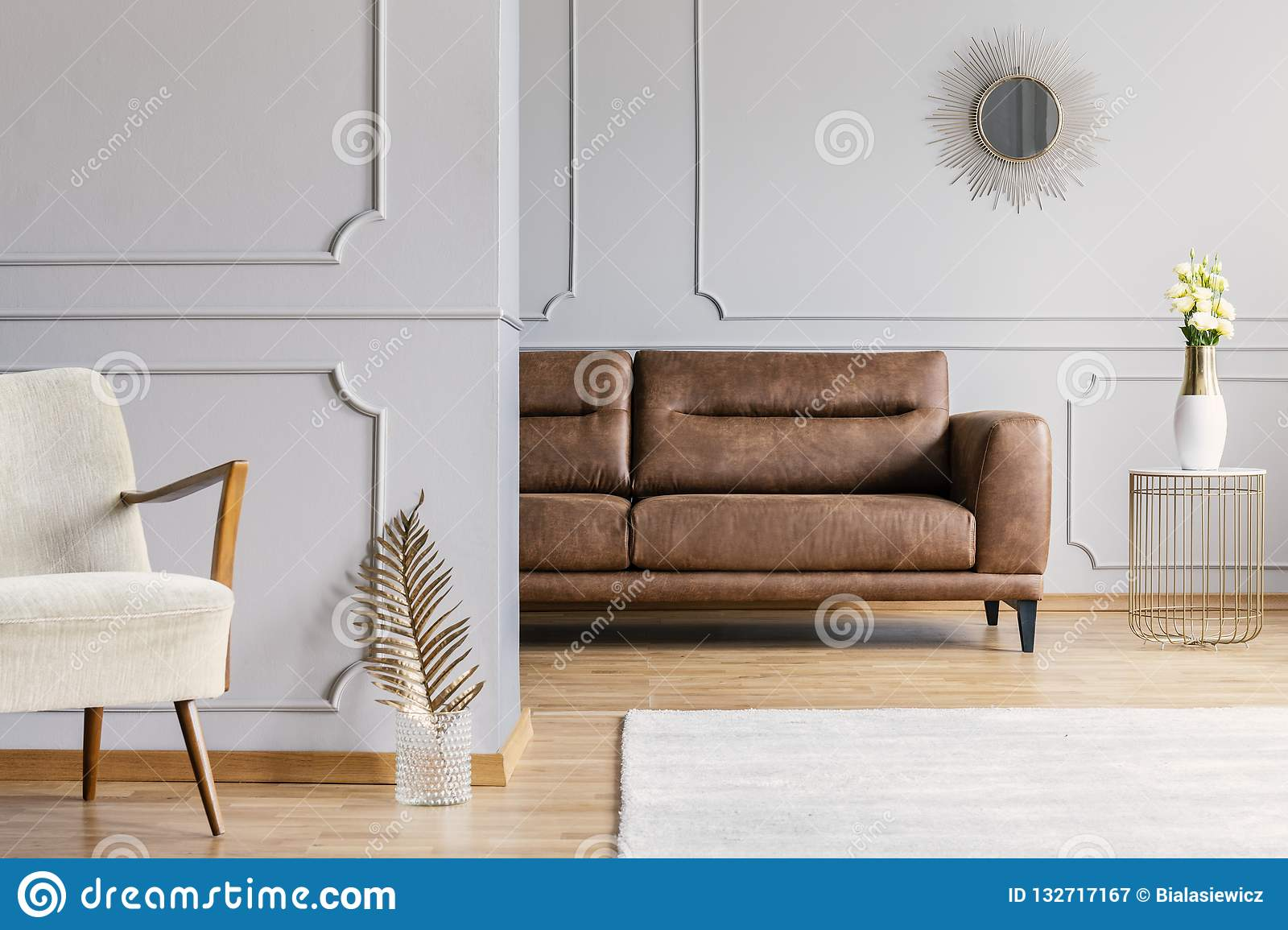Living Room Interior With Decorative Mirror On Wall With Wainscoting Brown Leather Sofa Fresh Roses On End Table And Stock Image Image Of Bright Furniture 132717167