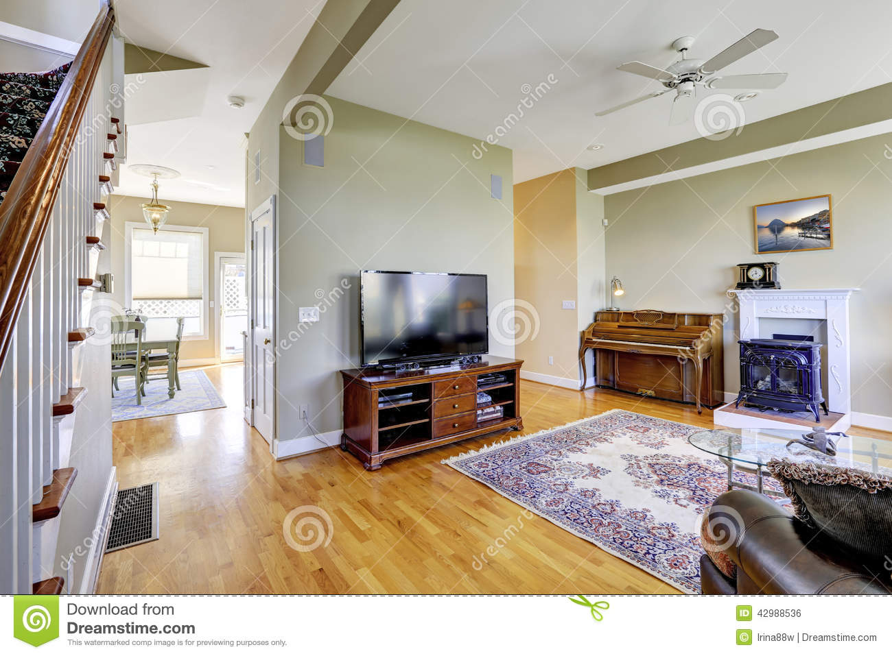 Living room interior with fireplace and piano stock photo for Above all grand salon