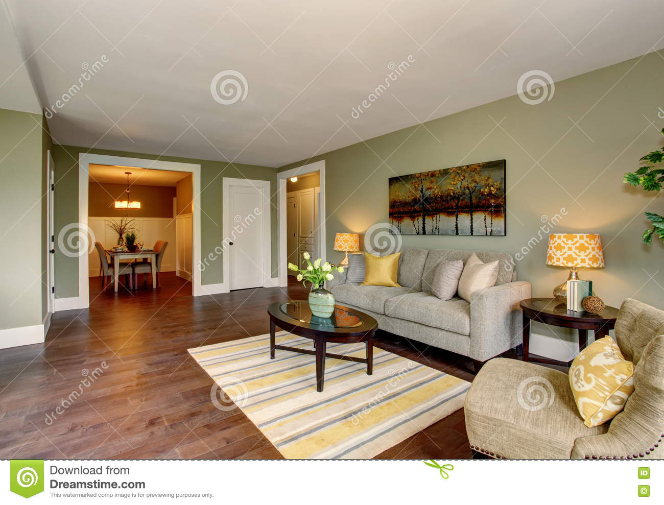 Living Room Interior With Green Walls Hardwood Floor And Rug ...