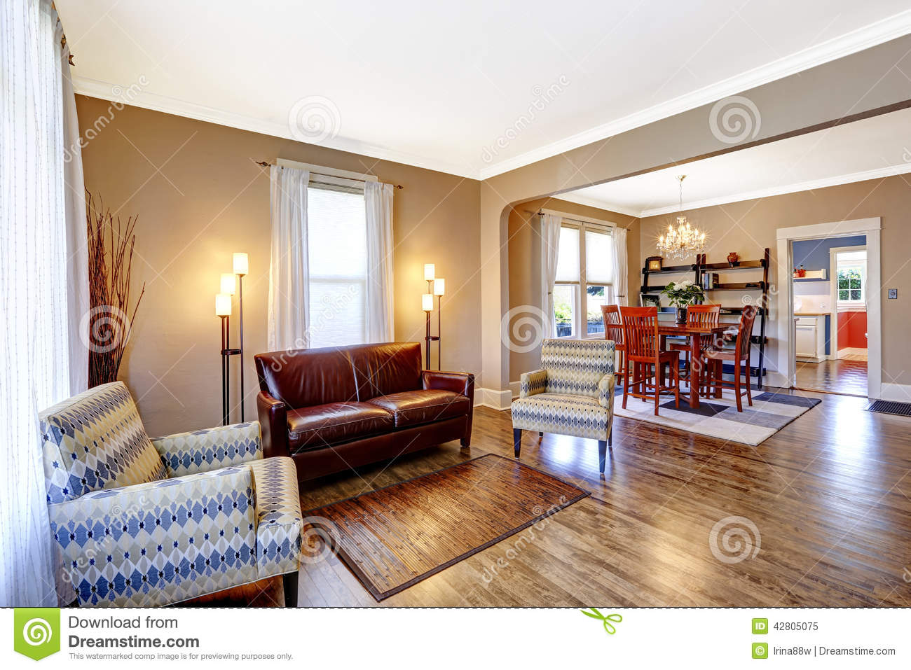 Living Room Interior With Leather Couch And Two Chairs