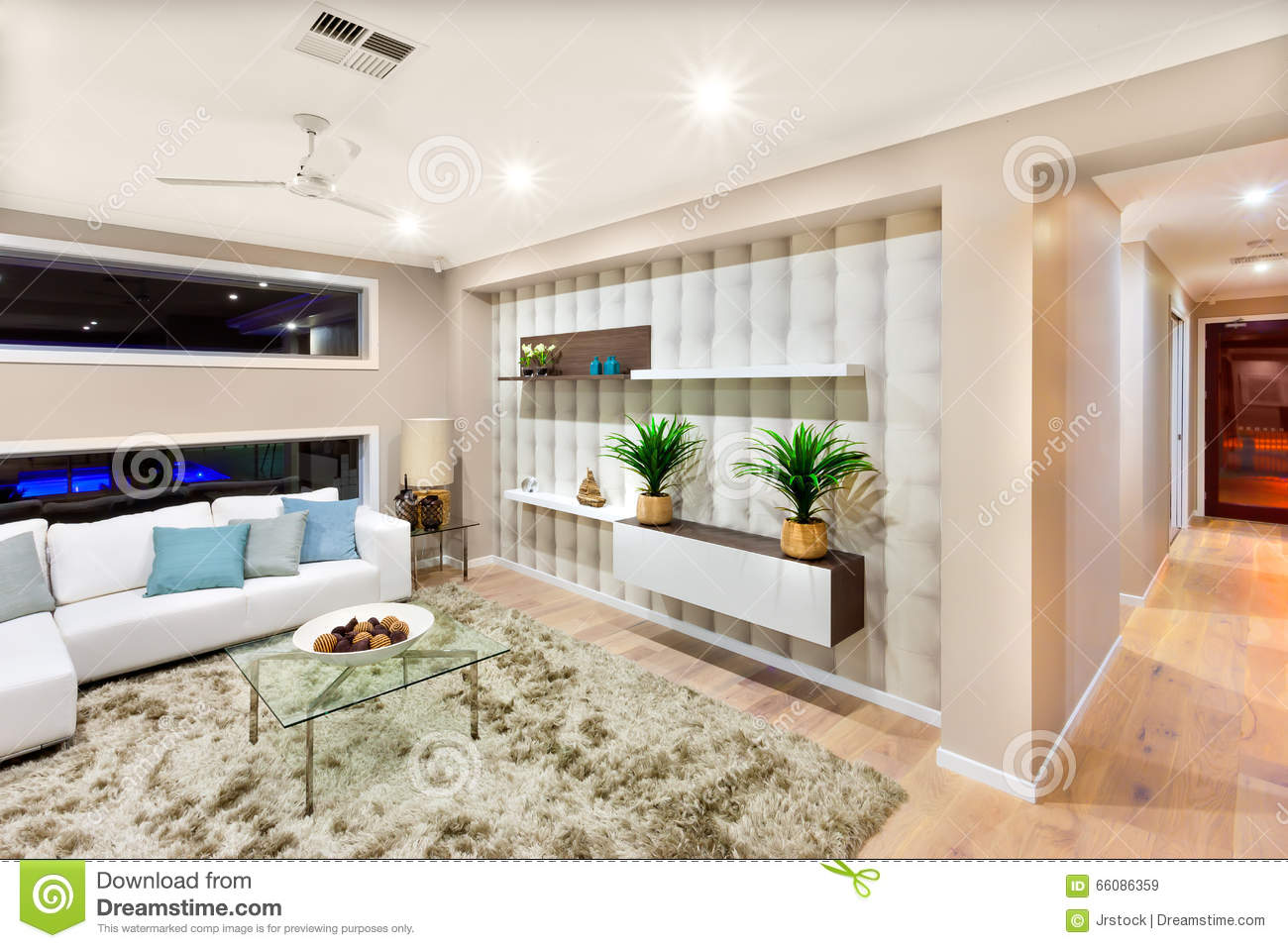 modern house lights. Living room interior of a luxurious house with lights on Room Interior Of A Luxurious House With Lights On Editorial