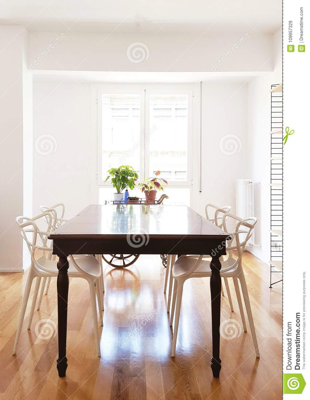 Wooden table in dining room with a window in the background