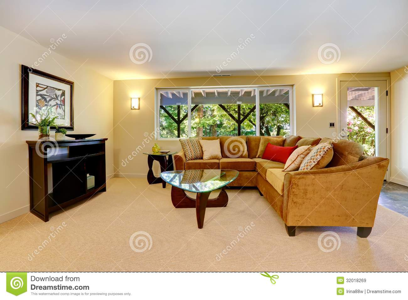 Living Room With Large Sofa Window And Carpet Royalty