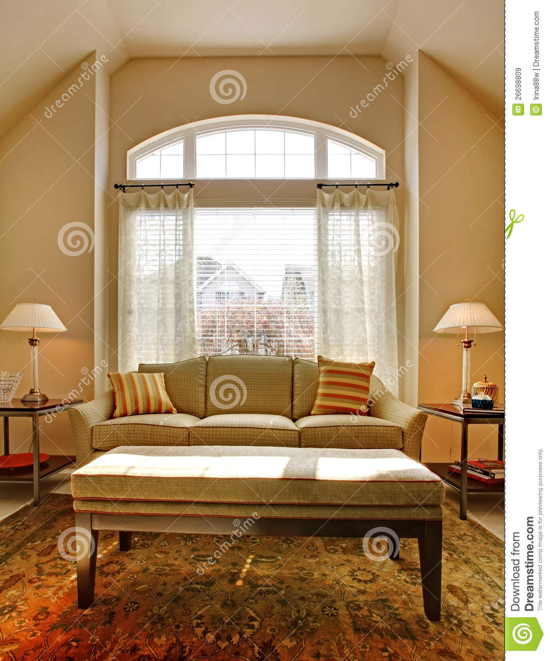 Living room with large window and classic sofa