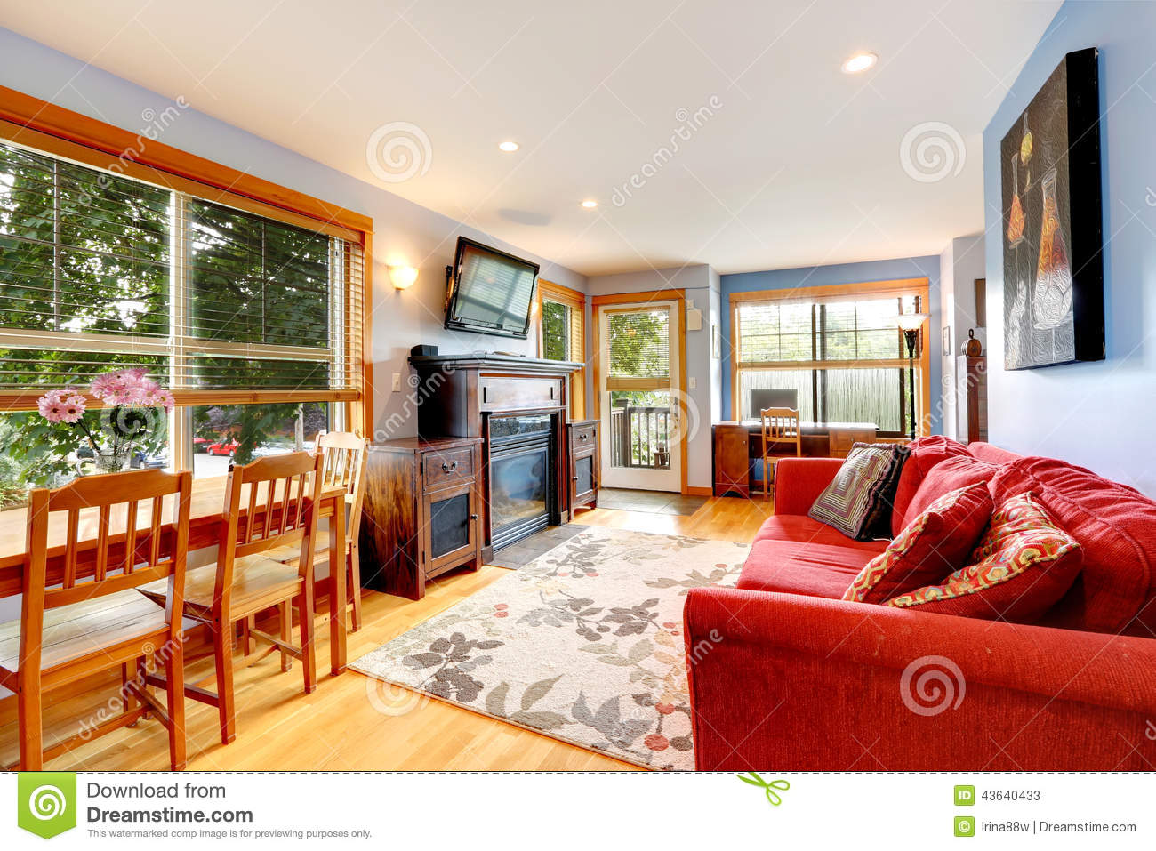 living room with office area and dining table stock photo
