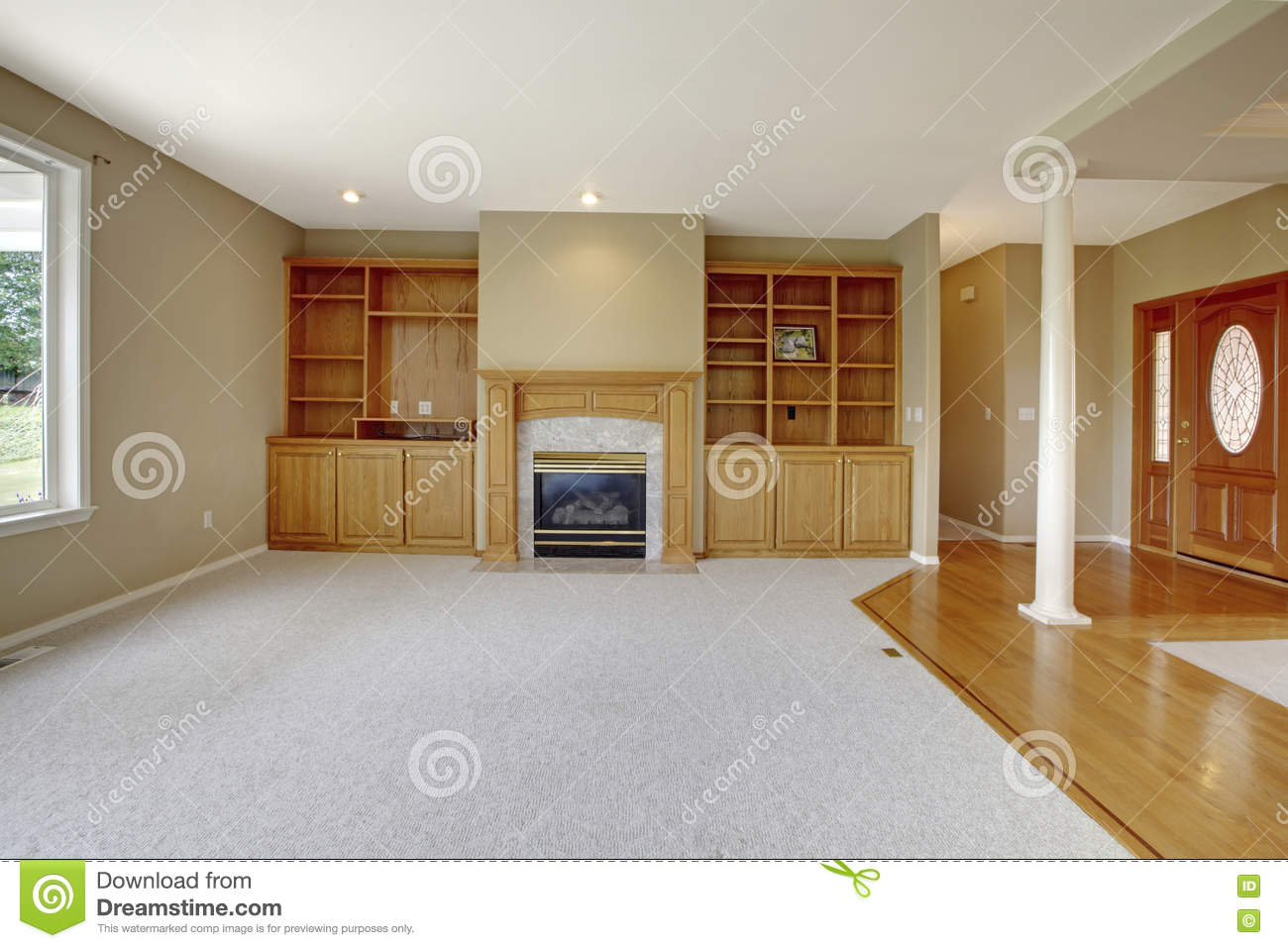 Foyer Open To Dining Room : Living room in open floor plan with foyer view and wooden entrance door stock photo image