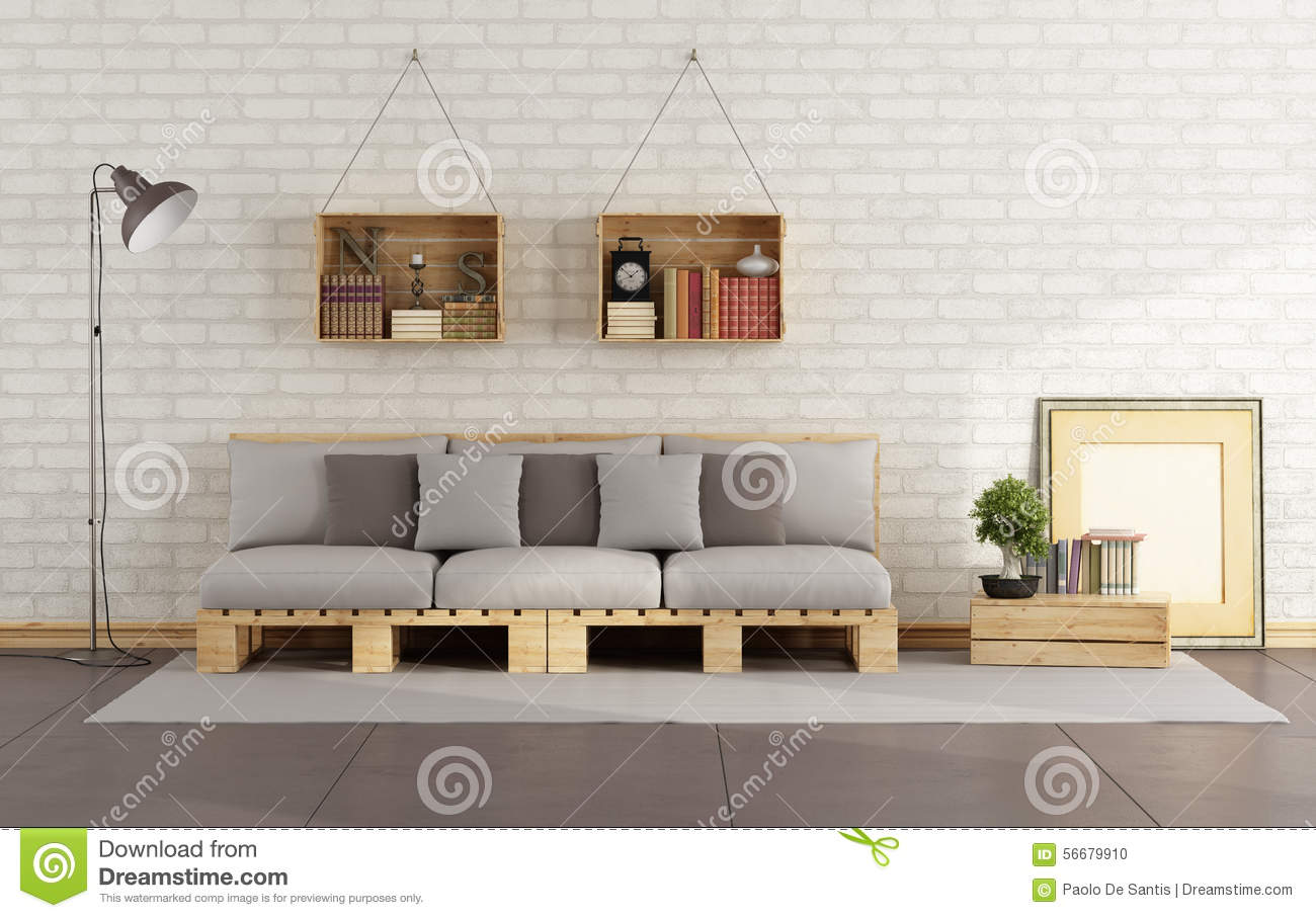 Living room with pallet sofa and wooden crate with books on brick wall  #84A824 1300x907