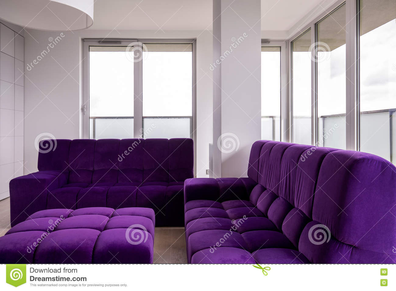 living room with purple furniture stock photo image
