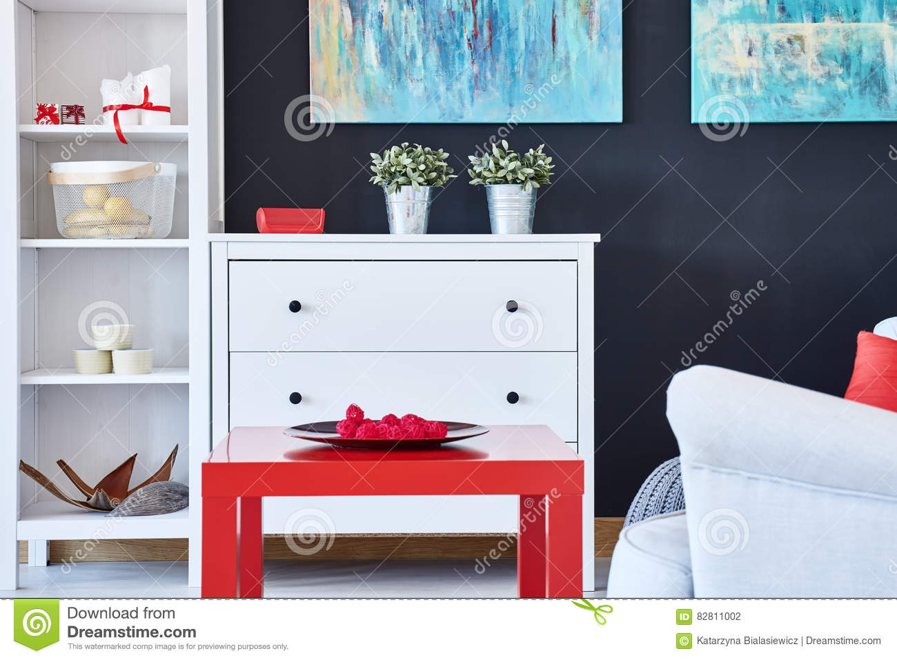 Living Room With Red Accessories