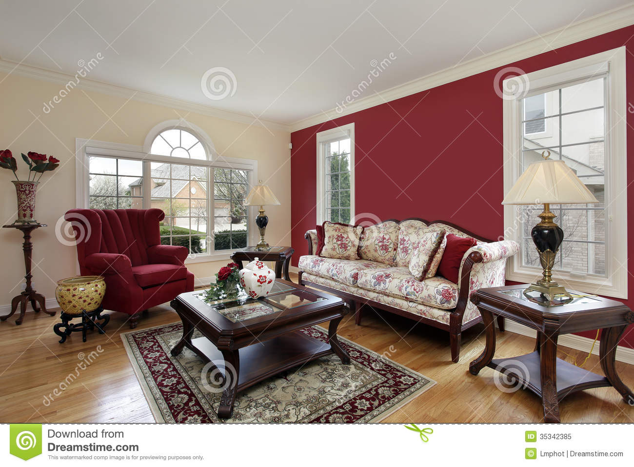 Living room with red and cream colored walls stock image for Cream and red living room designs