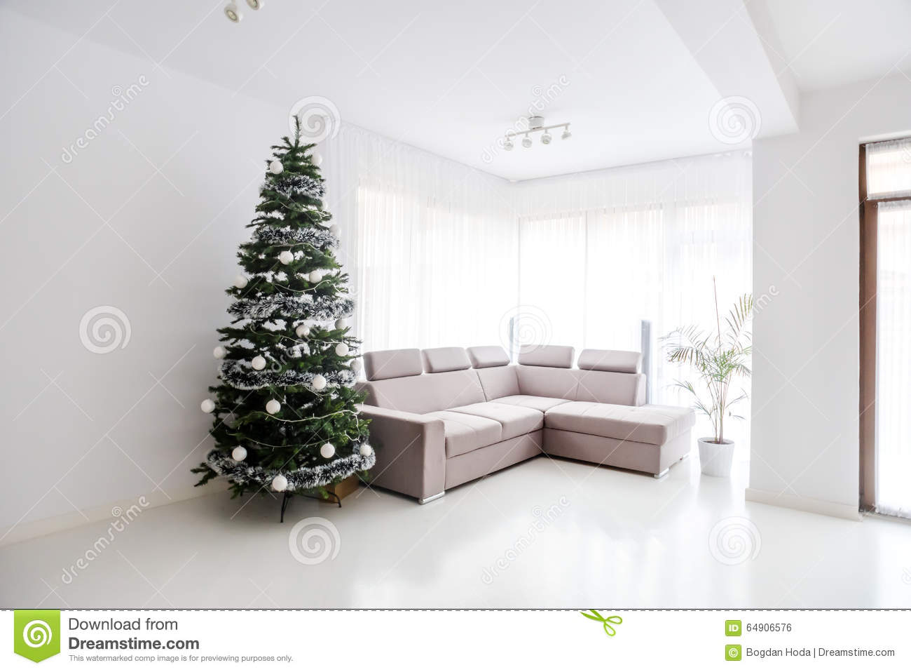 Living Room Space Comfortable Sofa And Christmas Tree In Large