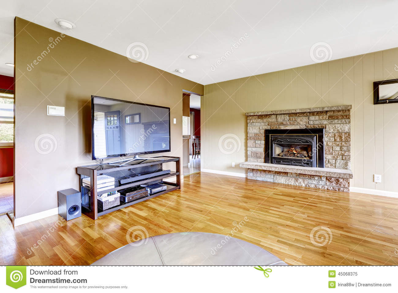 living room with stone trim fireplace and tv stock image - image of