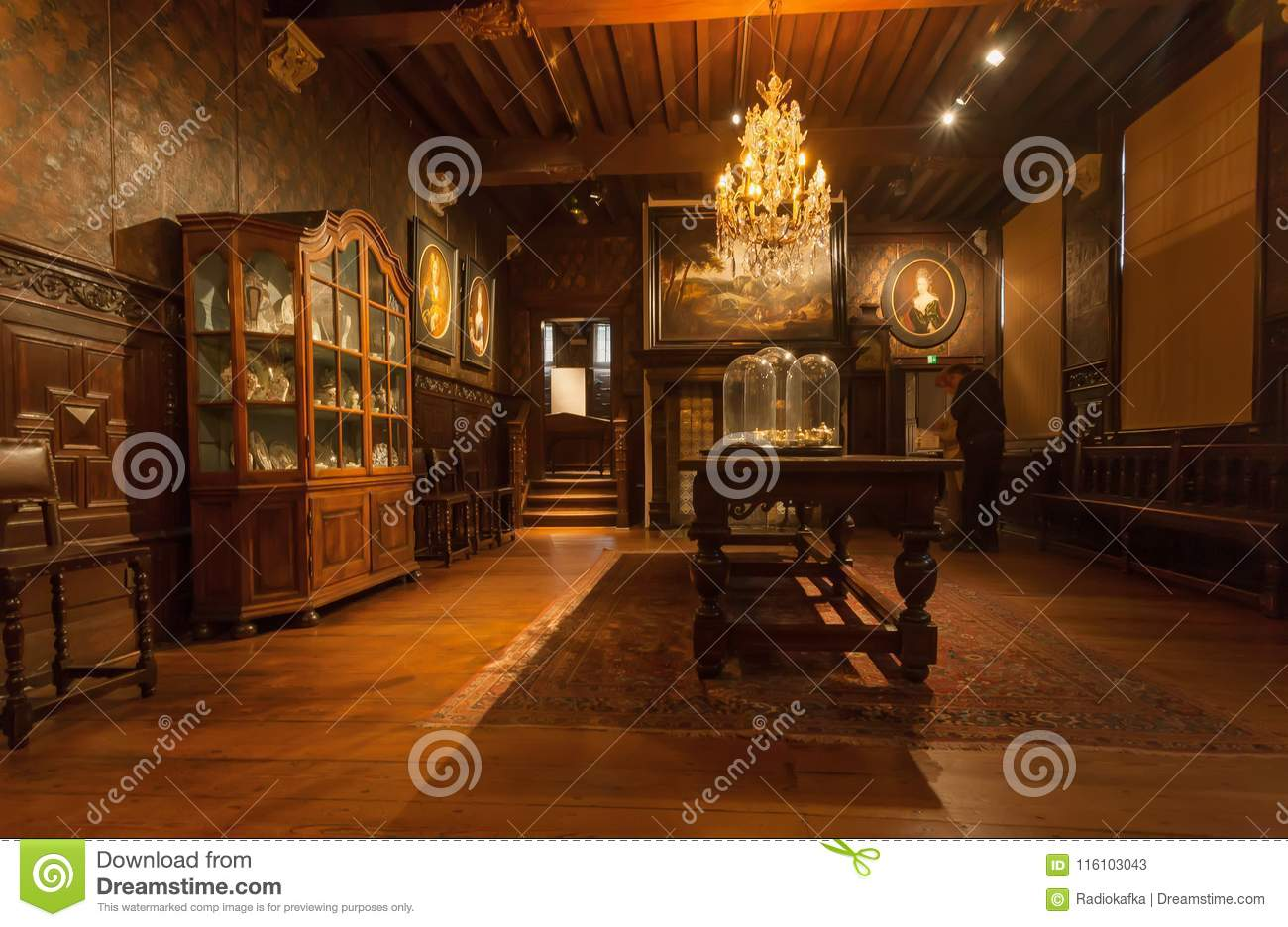 Antwerp belgium mar 30 living room with vintage chandelier and antique furniture in printing museum of plantin moretus unesco heritage site on march 30