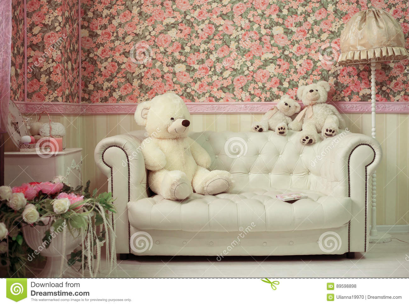 Living Room With White Sofa Teddy Bear Lamp And Fowers