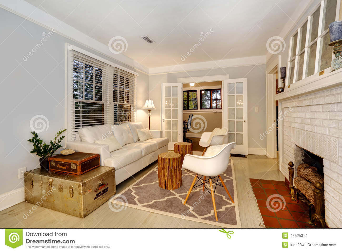 Living Room Wiht Fireplace Antique Chests And Modern Sofa And C Stock Photo