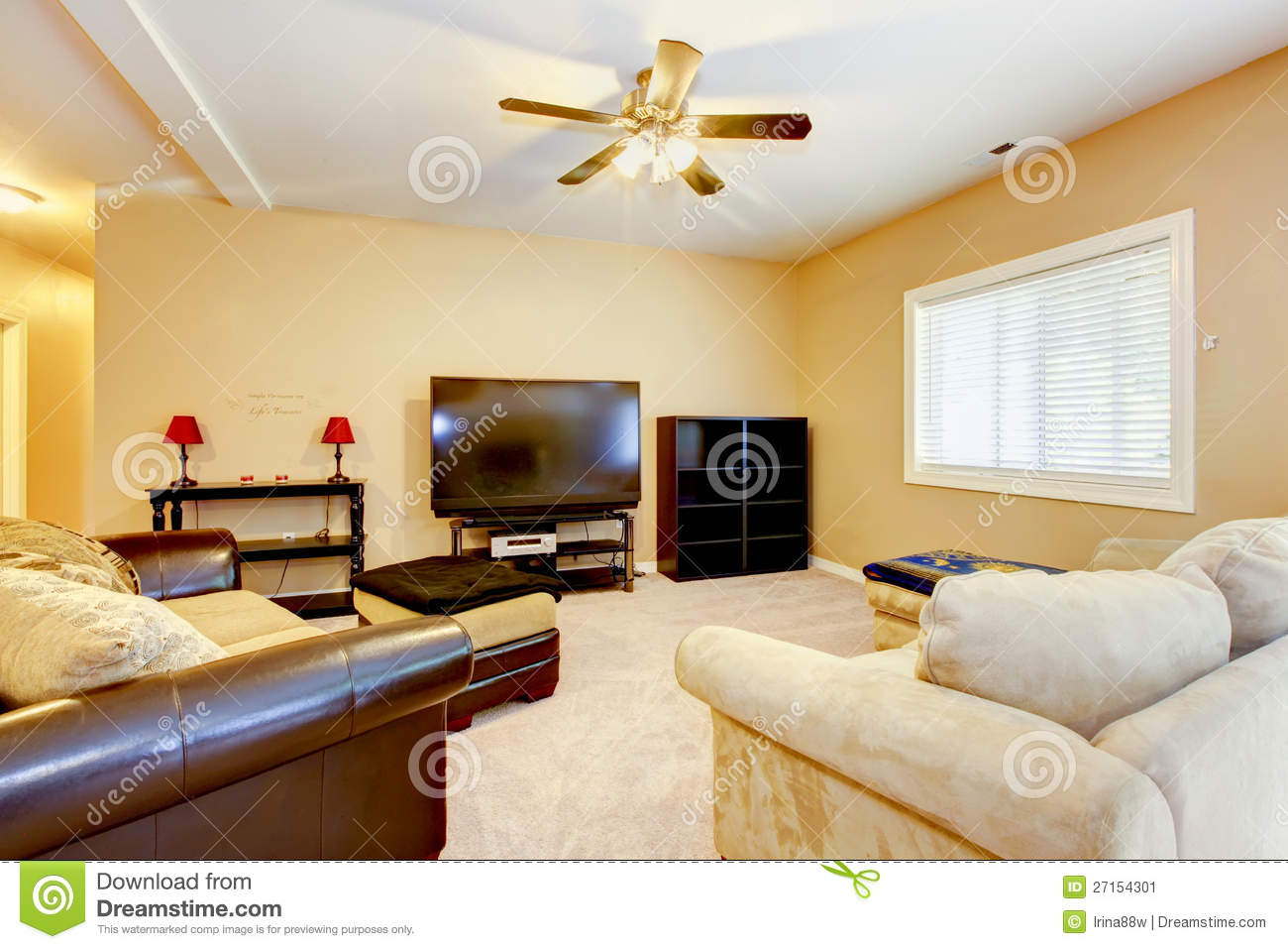 Living Yellow Room With Brown Sofas And Tv Stock Image