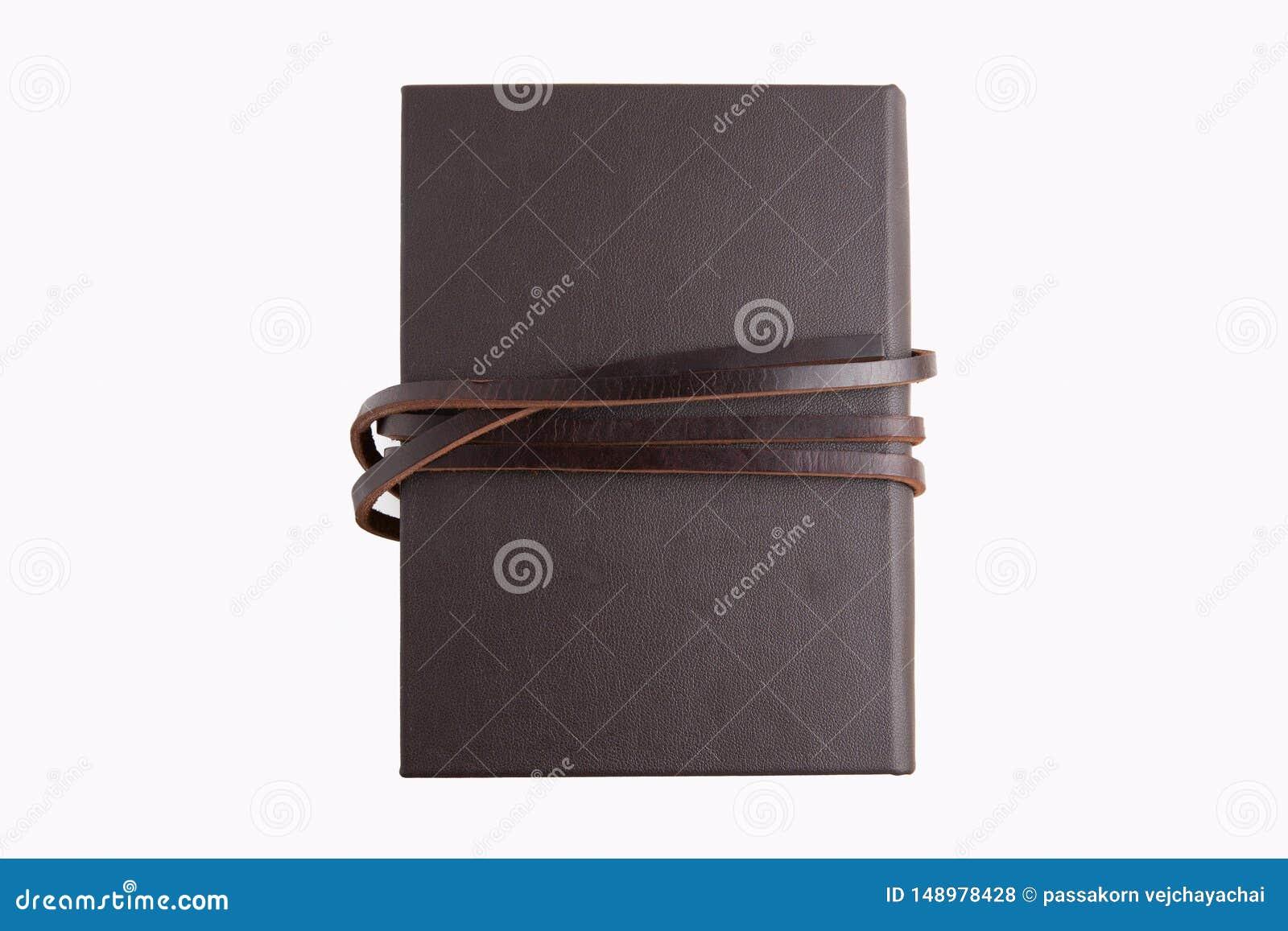 Livre en cuir brun secret avec le fond blanc