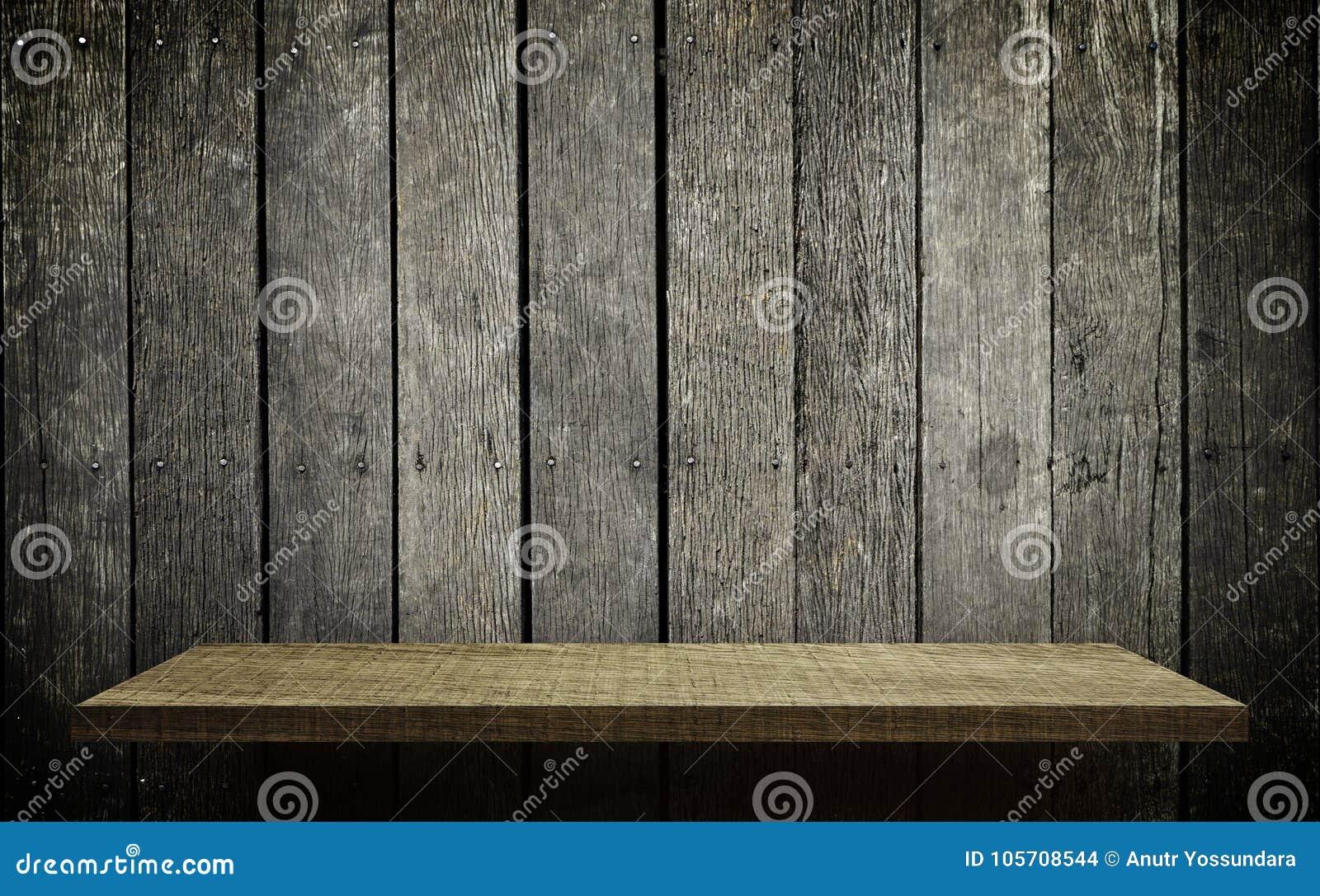 Ljus trähyllaskärm på den grungy wood väggen