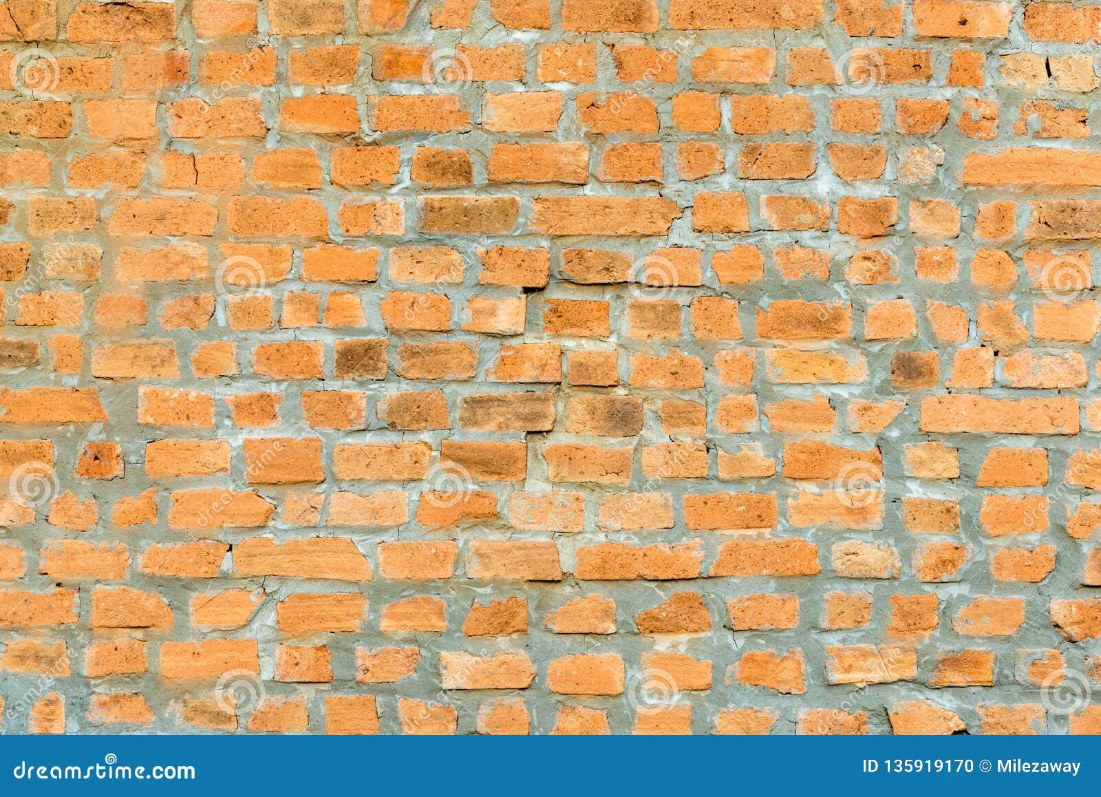Ljust - brun guling av tegelstenväggen
