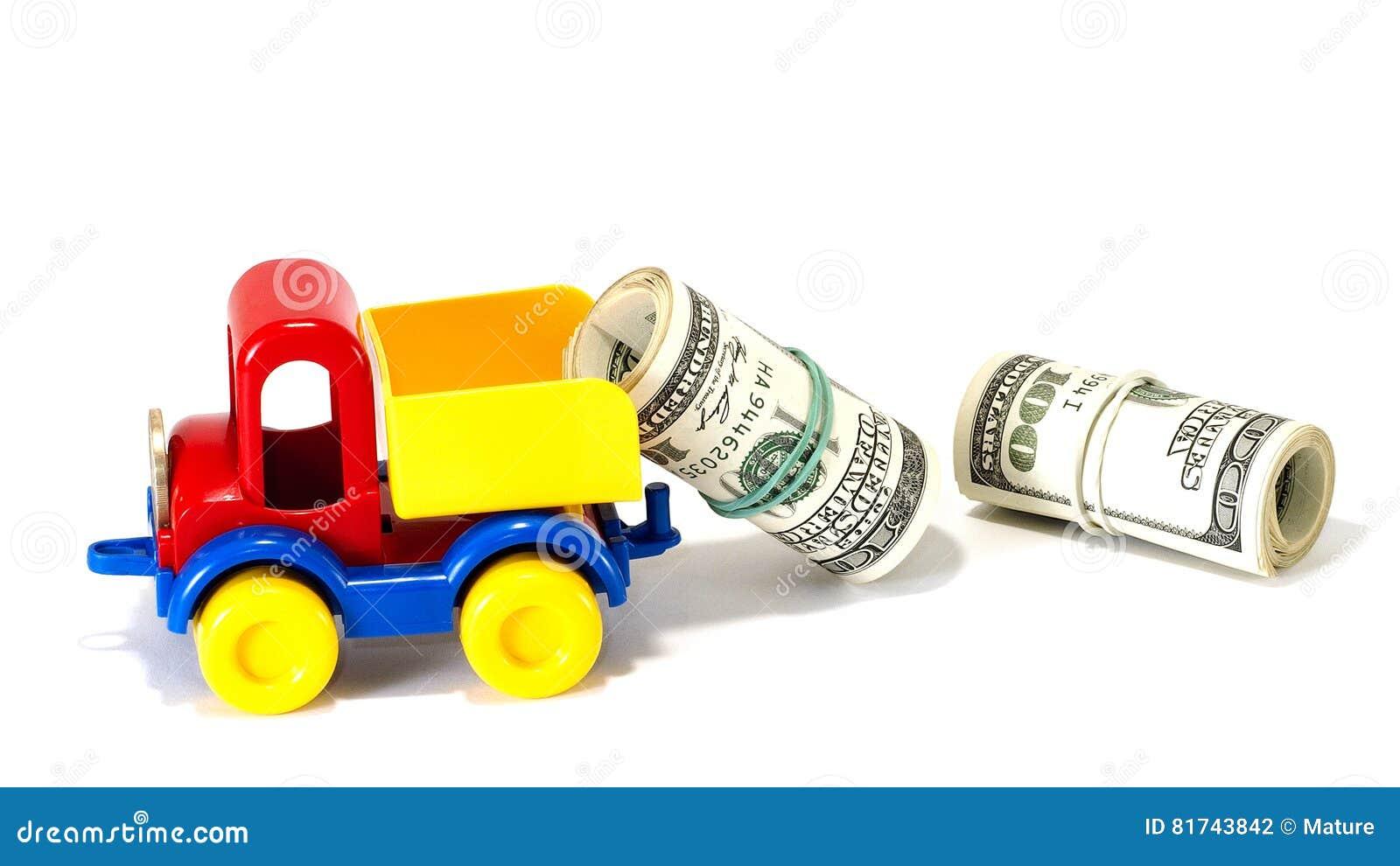 LKW-Spielzeug auf der Straße vom Geld
