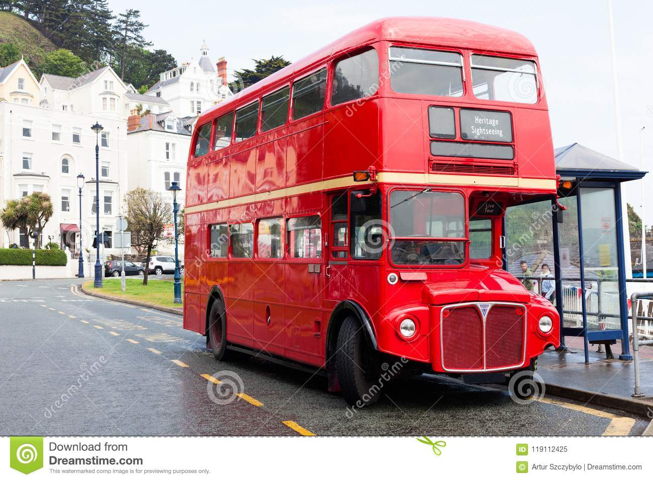 LLandudno, Wales, UK - MAY 27, 2018 Londons red double decker car parked on the road. buses on the stop. Tourism and touristic t