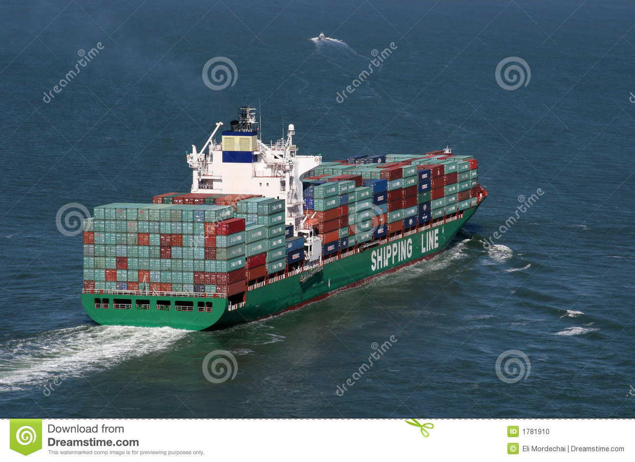fully loaded container or cargo ship leaves port and sails away into ...