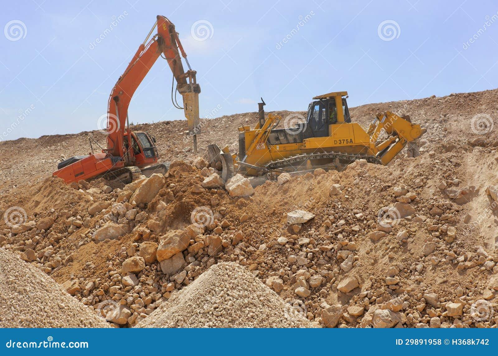 Construction Site Soil : Excavator machines loading soil royalty free stock photos