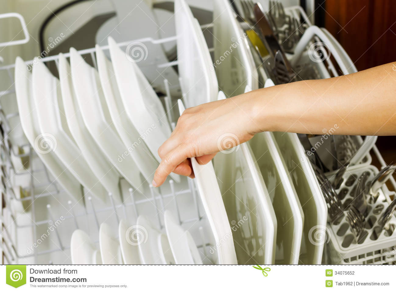 Dishes In Dishwasher ~ Loading dinner plates into the lower dish rack of