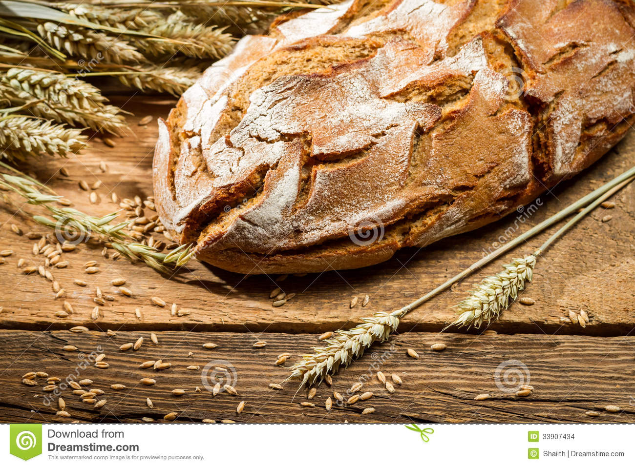 Loaf of bread in a rural bakery with wheat