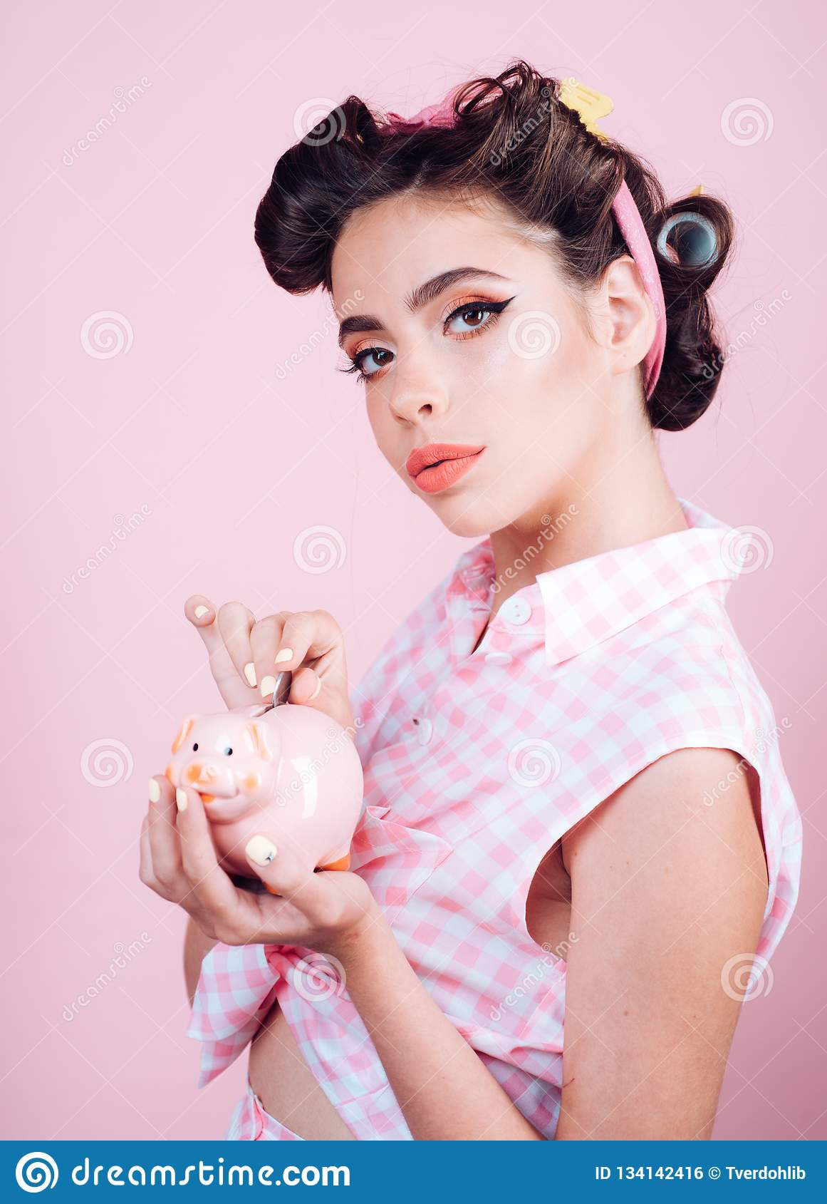 Loan. Money. Housewife. pin up woman with trendy makeup. pinup girl with fashion hair. retro woman with moneybox. pretty