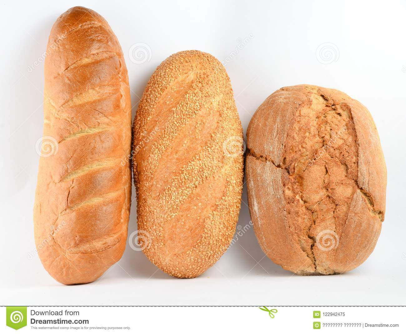 Loaves of bread isolated on white background. Wheat, rye, bread with sesame seeds