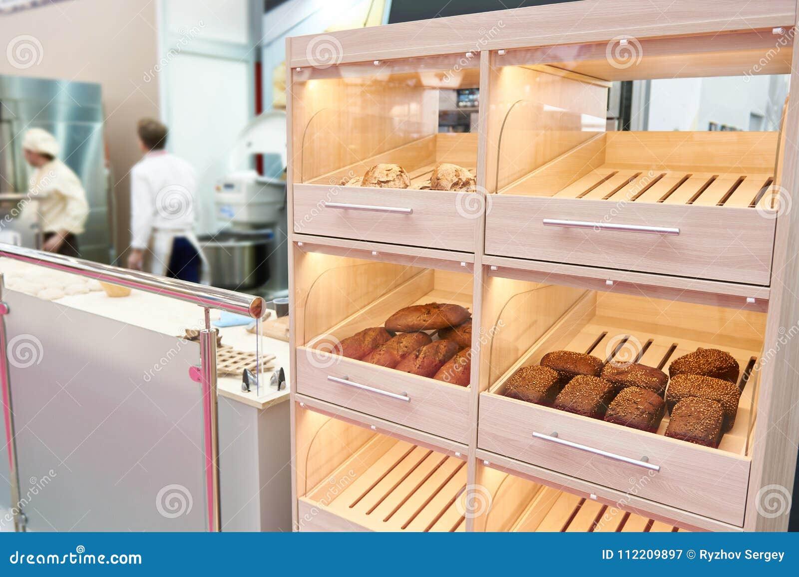 Loaves of bread on shelf in bakery