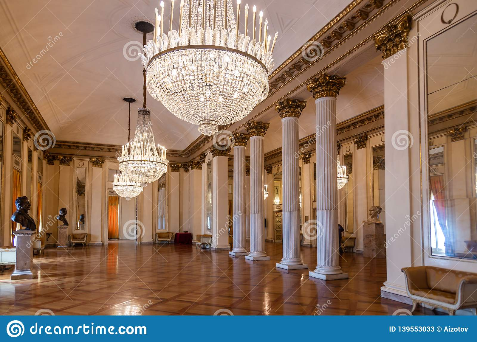 The lobby of the Milan Opera Theater La Scala with beautiful chandeliers and celebrity busts