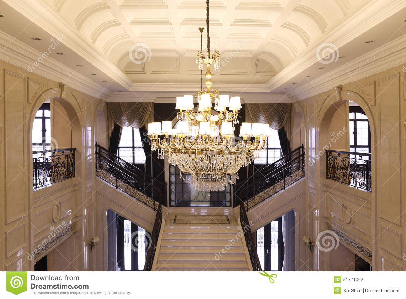 The lobby of the upscale office crystal droplight arches and windows stock photo