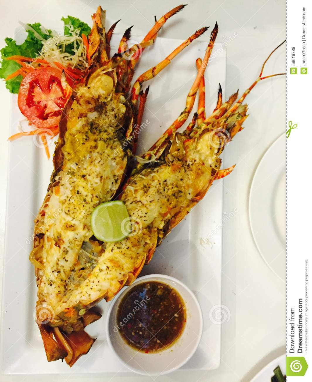 Barbeque lobster with lemon, garlic and butter sauce.