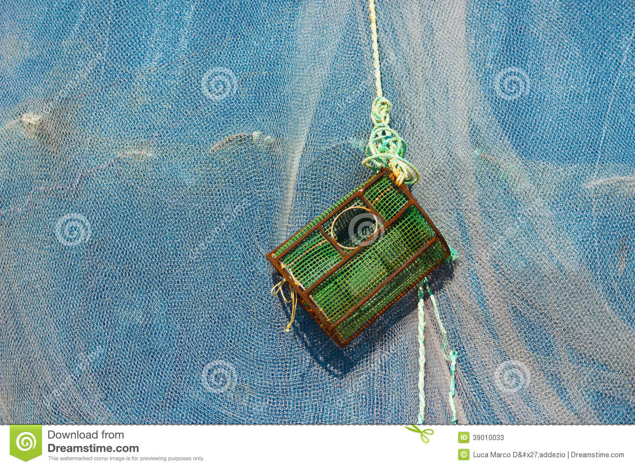 Lobster Pot Or Crab Trap Against A Fishing Net Stock Image - Image ...