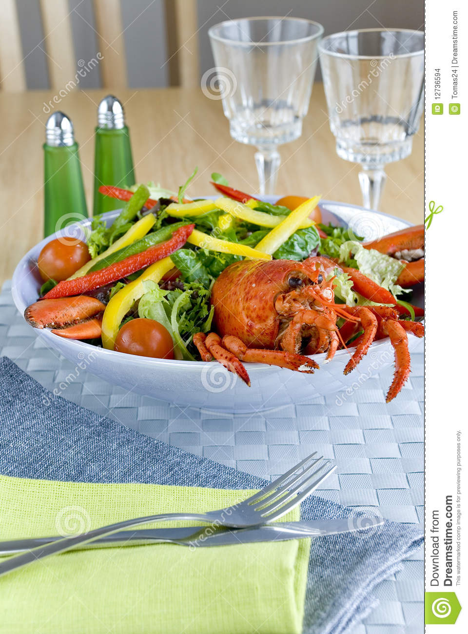 Delicious lobster salad with vegetables and poached lobster meat.