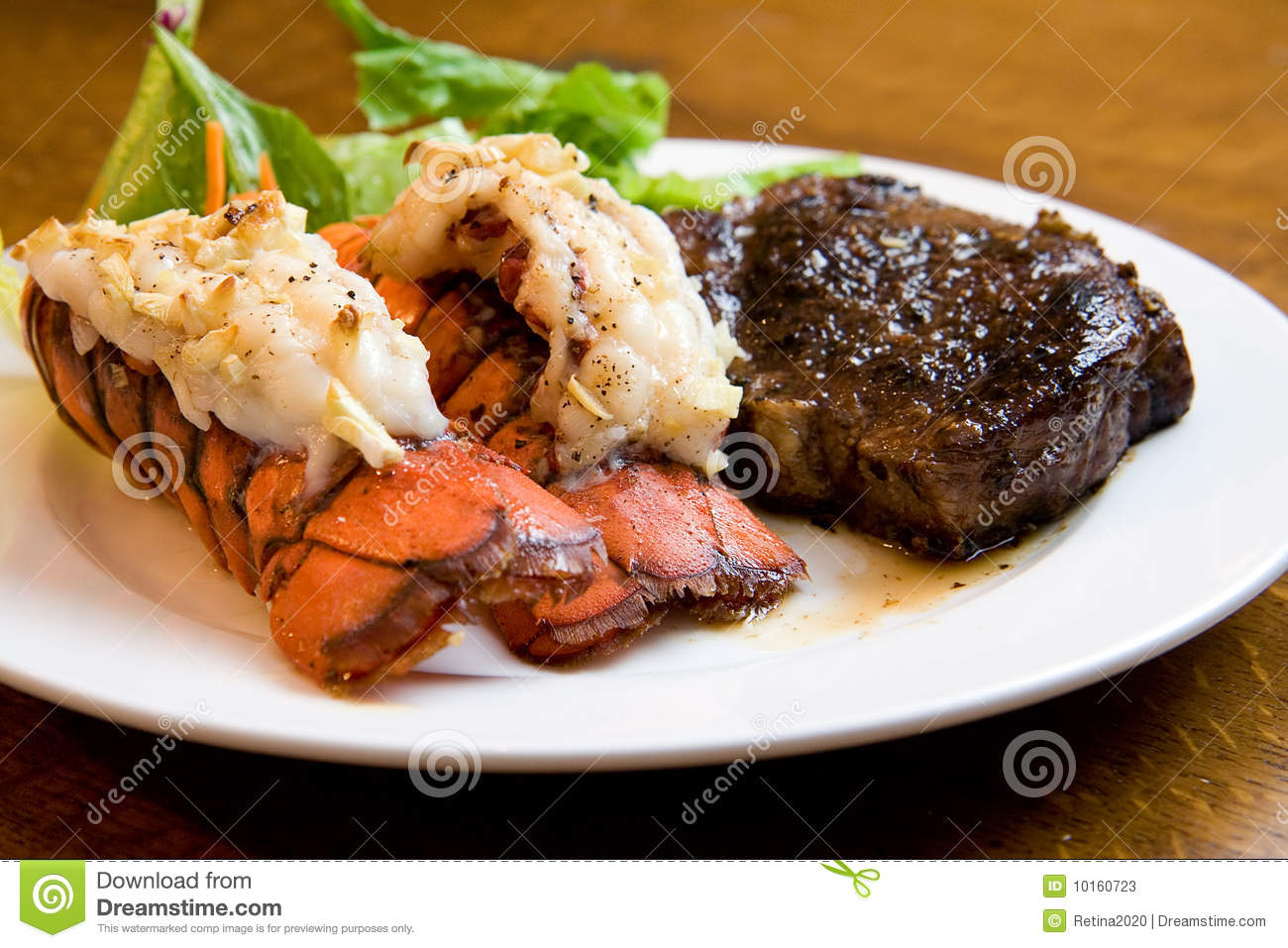 Juicy Grade AAA Angus New York Strip sirloin steak with Lobster Tails.