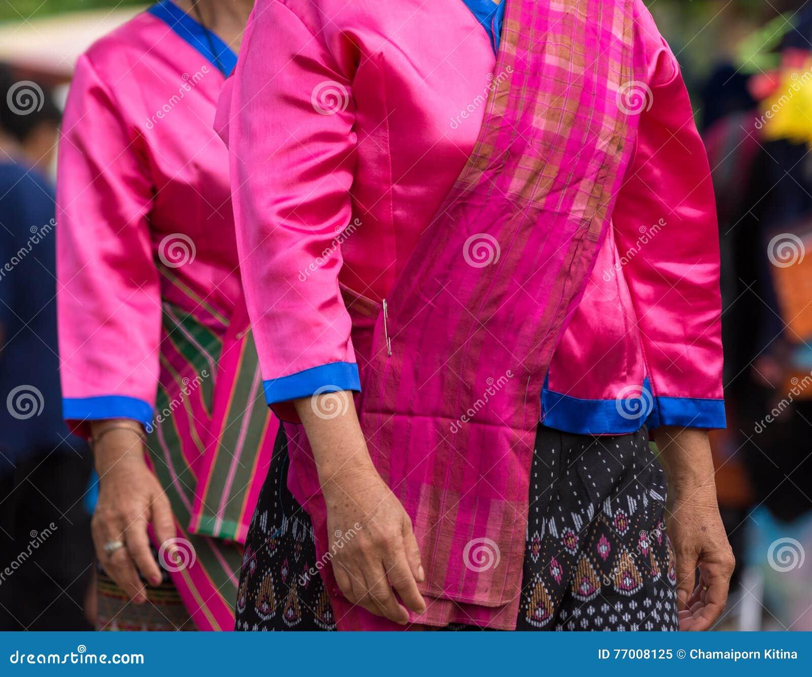 Local dress of female in Thai wax festival.