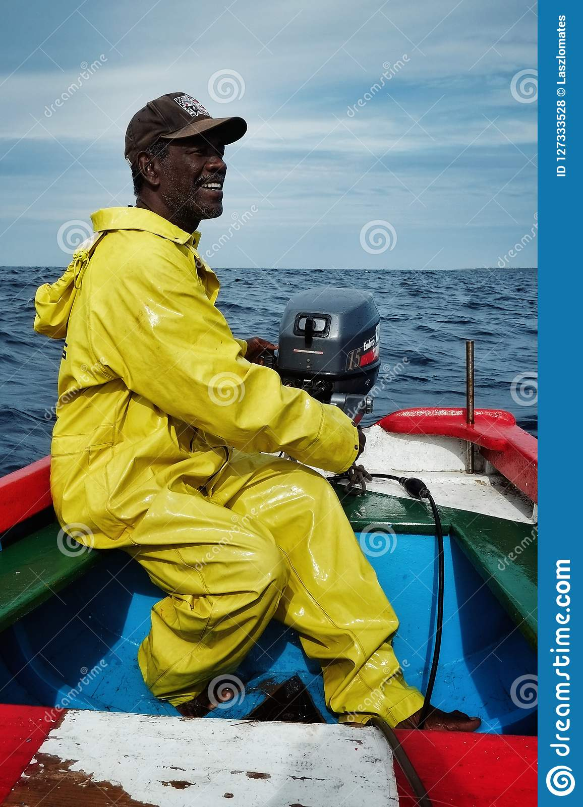 local fisherman going out to sea to fish for yellow fin tuna or wahoo in a traditional colorful dinghy