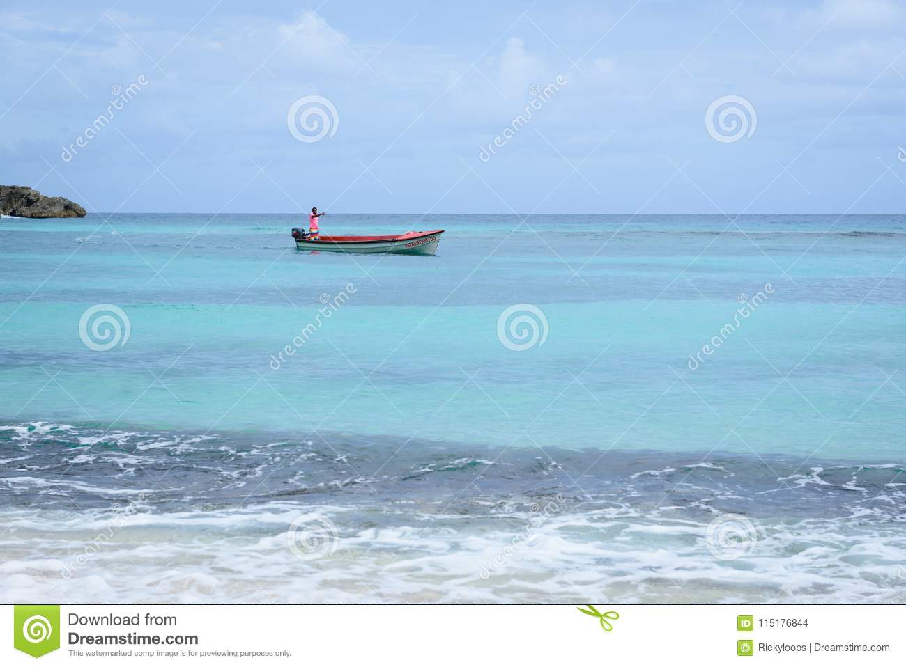 Local fisherman in his boat off the shore of Winifred beach Zion Hill, Portland, Jamaica, November 22, 2017